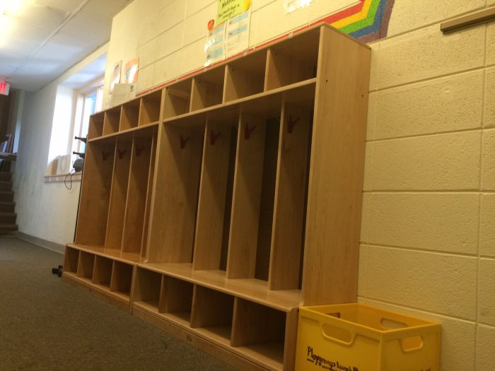 Children store their coats and backpacks in the cubbies outside the classroom.