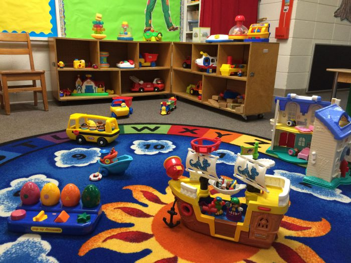 Age-appropriate toys and activities fill the classroom.